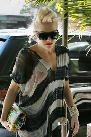 Gwen Stefani accessorized her edgy outfit with layers of beaded bracelets while running errands in LA.