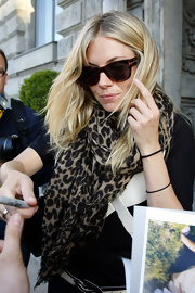Sienna Miller headed out in Berlin wearing a cool pair of Tom Ford tortoiseshell wayfarers.