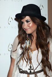 Demi Lovato completed her eclectic accessories with a silver cross pendant.