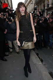 Lou Doillon continued the black and gold motif with a diamond-patterned clutch.