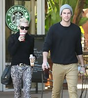Miley Cyrus accessorized with a classic black bucket bag by Chanel while out on a coffee run.
