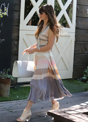 Jessica Biel stepped out in West Hollywood looking very chic in nude open-toe booties and a striped dress.