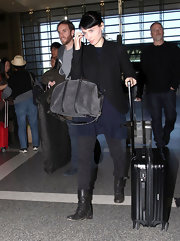 Rooney Mara finished off her edgy ensemble with black combat boots.