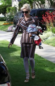Gwen Stefani attended a christening wearing a fun-looking striped skirt suit.