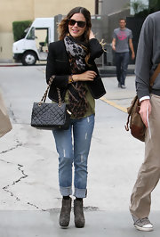 Rachel Bilson contrasted her elegant jacket with casual ripped jeans.