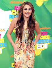 Miley Cyrus styled a floral dress with long layered necklaces by Loree Rodkin for her 2011 Nickelodeon Kids' Choice Awards look.