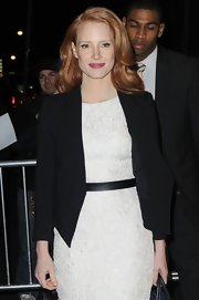 Jessica Chastain looked sharp in a black Helmut Lang tux jacket layered over an LWD while visiting 'The Daily Show.'