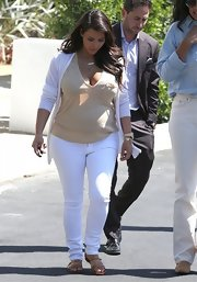 Kim Kardashian stepped out in Beverly Hills wearing a low-cut nude maternity top.