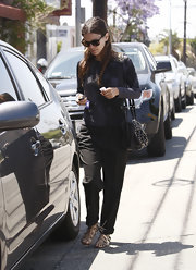 Rachel Bilson chose simple black slacks to pair with her top.