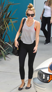 Miley Cyrus finished off her outfit with cute black ballet flats by Balenciaga.