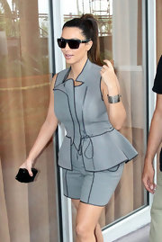 Kim Kardashian's silver cuff and gray romper combo had cool, futuristic feel.