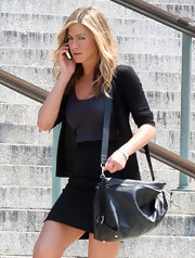 Jennifer Aniston accessorized with a stylish black Ferragamo shoulder bag while filming 'The Bounty.'