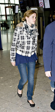 Emma Watson kept her travel outfit cute and comfy with a pair of laser-cut ballet flats by Jeffrey Campbell.