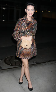 Katy Perry kept it cute all the way down to her bow-adorned ballet flats.