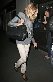 For her bag, Sienna Miller kept it simple with a small black duffle.