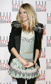Sienna Miller accessorized with a classic gold bangle bracelet by Tiffany & Co.
