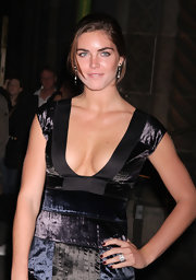 Hilary Rhoda sported red nail polish for a pop of feminine color to her dark dress.