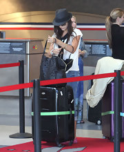 Camilla Belle was spotted at LAX rummaging through an oversized laser-cut tote.
