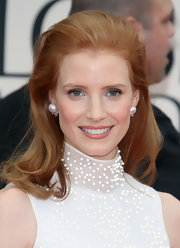 Jessica Chastain complemented her beaded gown with classic pearl studs.