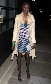 Alek Wek arrived at the Tribeca Ball wearing a glamorous fur-lined leather coat over a print dress.