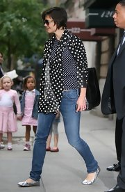 For a touch of shine, Katie Holmes donned a pair of silver ballet flats by Lanvin.