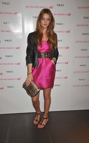 Rosie Huntington-Whiteley opted for an edgy-casual pair of studded T-strap sandals to complete her outfit.