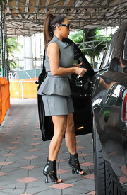 Kim Kardashian wore ultra-modern Balenciaga open-toe boots for a day of shopping in Miami.