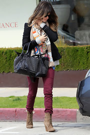 Rachel Bilson looked colorful in purple Paige skinny jeans and a floral scarf while leaving a hair salon.