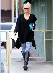 Gwen Stefani looked edgy-stylish in a baggy black knit vest with zipper detail on both sides while out and about in Studio City.