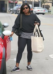 Mindy Kaling looked cozy in a gray boatneck sweater layered over a striped shirt while shopping in West Hollywood.