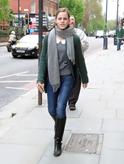 Emma Watson was spotted out in London wearing a green shawl-collar cardigan over a collared gray top.