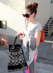 Miley Cyrus was spotted out in West Hollywood carrying a Coach logo tote.