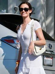 Emmy Rossum went white-on-white with this chain-strap bag and knit dress combo while out and about in Beverly Hills.