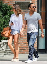 Chrissy Teigen completed her strolling ensemble with a pair of flat T-strap sandals.