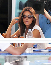Kim Kardashian hid her eyes behind a chic pair of cateye sunnies while dining in Miami.