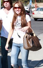Miley Cyrus looked sporty in her shield sunglasses while out in LA.
