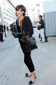 Ines de la Fressange fused comfort and style in a pair of satin ballet flats at the 2010 Spring Lanvin presentation.