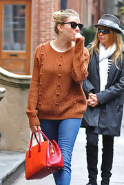 Sienna Miller headed out in the Big Apple carrying a chic Miu Miu leather tote in two shades of red.