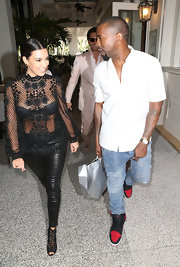 Black Dolce & Gabbana lace ankle boots added an extra dose of sexiness to Kim Kardashian's look.