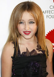 Noah Cyrus sported a loose straight cut with parted bangs at the Dreamn Halloween event.