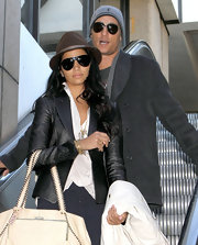 Camila Alves arrived on a flight at LAX wearing a pair of sporty aviators.