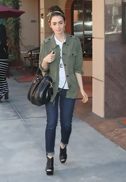 Lily Collins added some toughness with a military jacket.