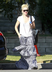 Gwen Stefani styled her plain top with a boho-chic tiered maxi skirt.