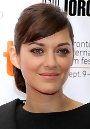 Marion Cotillard looked youthful with her ponytail and side-swept bangs at the 'Little White Lies' premiere.