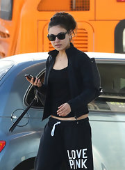 Mila Kunis stepped out for some errands wearing a classic pair of wayfarers.