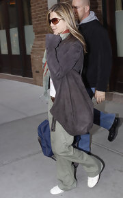 Jennifer Aniston accessorized with an oversized gray suede bag.