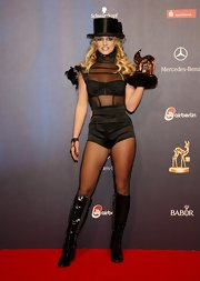 Britney stole the show at the Bambi Awards in a black sheer black bodysuit and top hat.