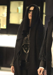 Katy Perry went incognito with a black knit scarf while making her way through LAX.