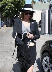 Jennifer Lawrence accessorized with fringed black suede bag while out shopping at Vera Wang.