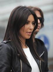 Kim Kardashian wore her hair with a center part and sleek straight layers while touring London.